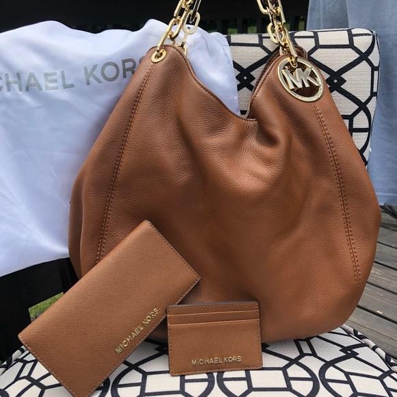 Michael Kors Handbags - Michael Kors Fulton Large Luggage Leather Hobo
